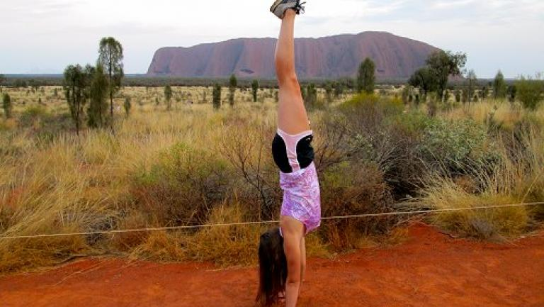 Student in front of Ayers Rock
